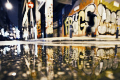 Reflection of shops on a wet road