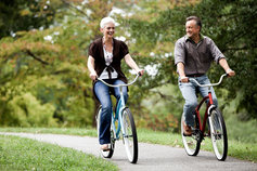 Senior couple biking together