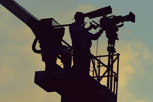 Man shooting from camera roll on crane