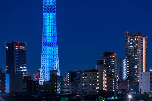 blue lit tower at night