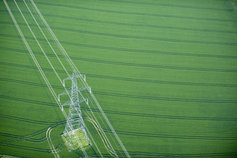 Electricity pylon in wheat field right angle