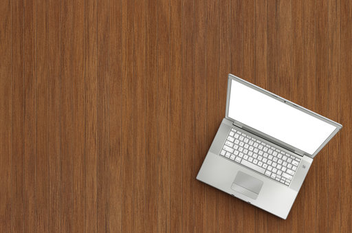 laptop on wooden background