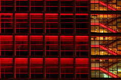 European Banking Transaction Tracker - photo of a glass building's staircase lit in red