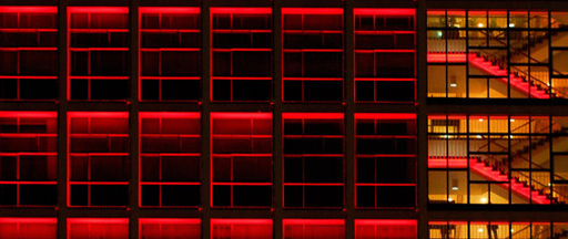 red lit glass building