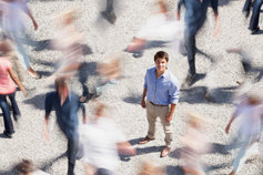 Smiling businessman in crowded street