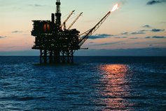 Oil rig at sea with gas flame