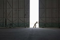 Person opening a hangar door