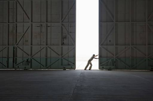 KPMG IFRS for banks | EDTF 2015 report article image | Person opening a hangar door