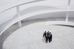 business people standing in a modern courtyard