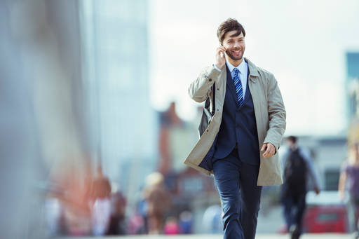business-man-walking-taking-cell-phone