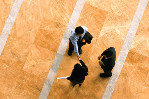 Aerial view of business people shaking hands