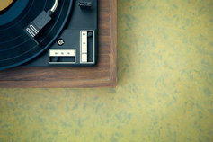 Record player on green table