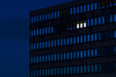 lighted windows in office building