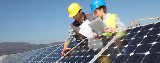 Man showing solar panels to student