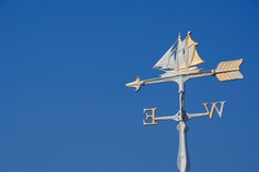 Sailboat wind vane against clear sky
