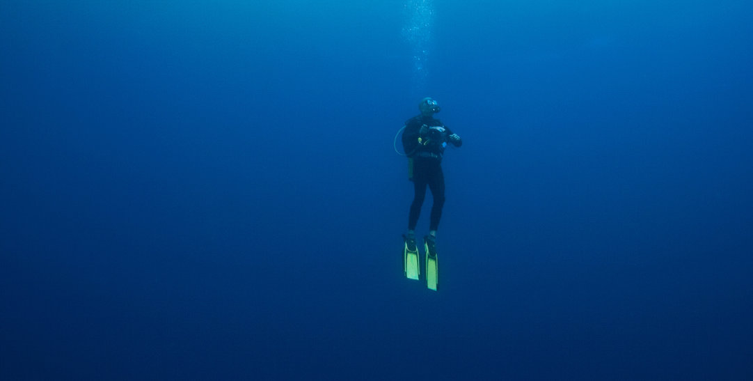 scuba-diver-floating-mid-water
