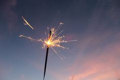 Sparkler beneath the pink streaked sky