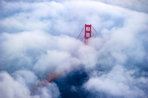 View of the Golden Gate Bridge, San Francisco emerging from the clouds