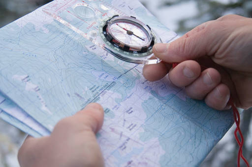 Man holding a dial over the map