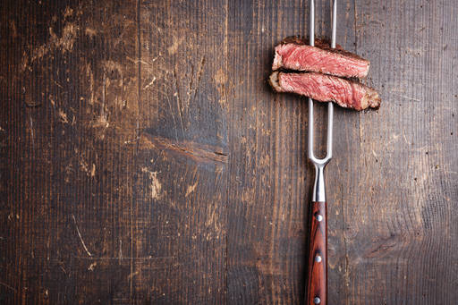 red meat on fork