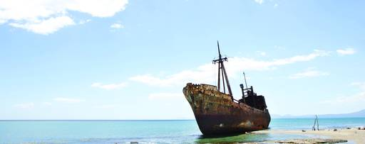 KPMG IFRS Newsletter: IFRS 9 Impairment publication image: rusting hull of a ship on a beach,KPMG IFRS Newsletter: Financial Instruments publication image: windsurfer jumping a wave