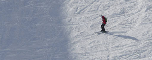 KPMG IFRS income taxes topic image: Lone skier negotiating downhill course.