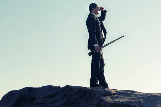 Man in suit, up a mountain