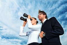 Woman and man looking through binocular