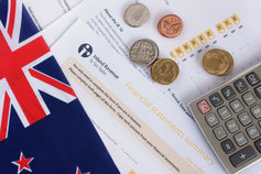 Tax nz coins, calculator and flag