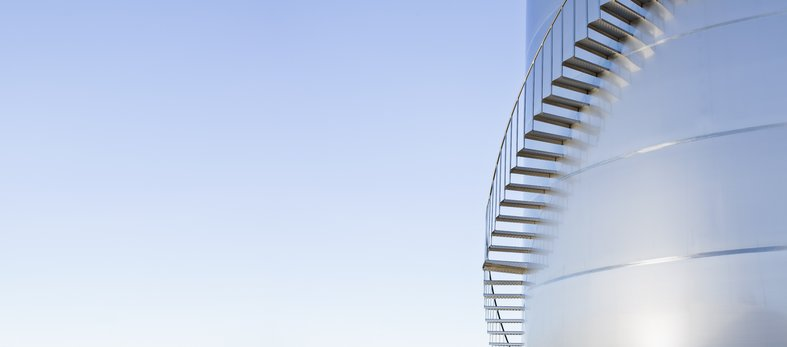 ascending stairs up oil storage tank