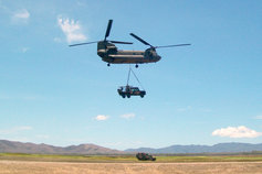 Australian army vehicle slung under Chinook helicopter