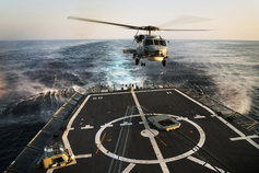 HMAS Melbourne's embarked Seahawk helicopter prepares to land