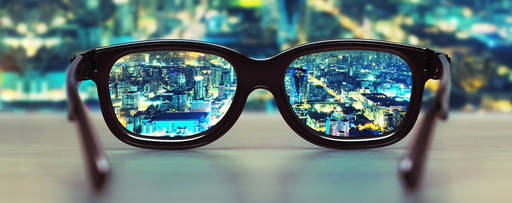 glasses focusing on city skyline