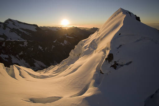 snowy mountain peak sunrise