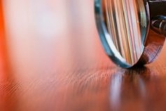 a magnifying glass on desk