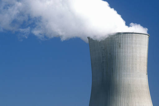 smoke coming out of a nuclear power plant chimney