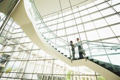 hu-business-people-taking-on-office-staircase.jpg