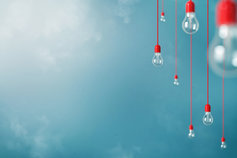Energy policy updates - lightbulbs hanging on wire