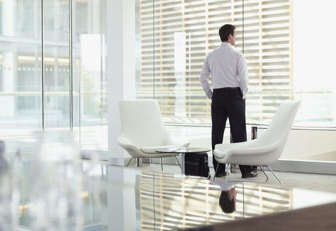 Man looking out of office window