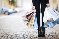 kpmg ifrs | revenue | person on a cobbled street holding shopping bags