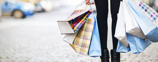 KPMG IFRS revenue topic image: colourful shopping bags in cobbled street