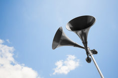 Pensions Communications - image gramophone speakers outside