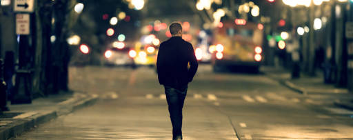 man walking down street