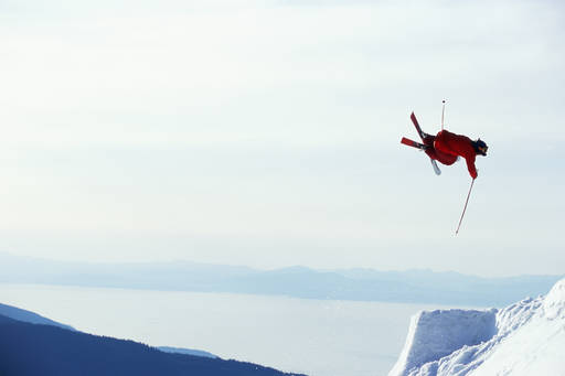 skiing with red jacket