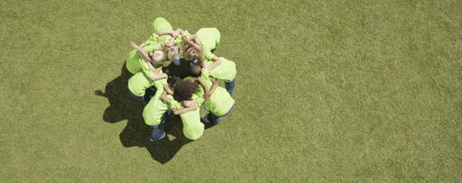 KPMG Corporate responsibility - Photo of children in a huddle