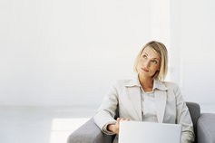 Businesswoman sitting in front of a laptop