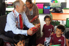 New Zealand Edmund Hillary School children accepting Christmas gift