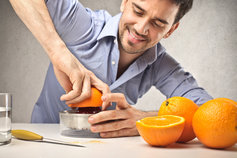 Man squeezing orange