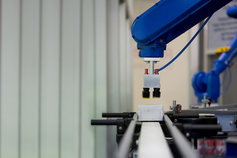 Robotic arm positioned over steel rails