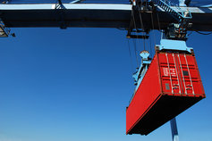 Shipping container being moved on a crane